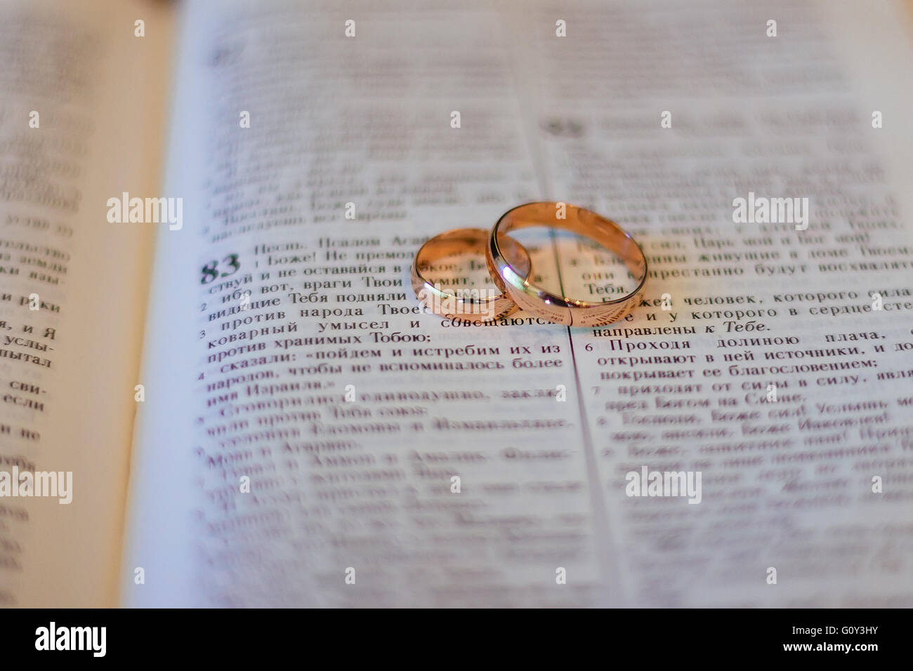 Two wedding rings on a bible Stock Photo 103857767 Alamy