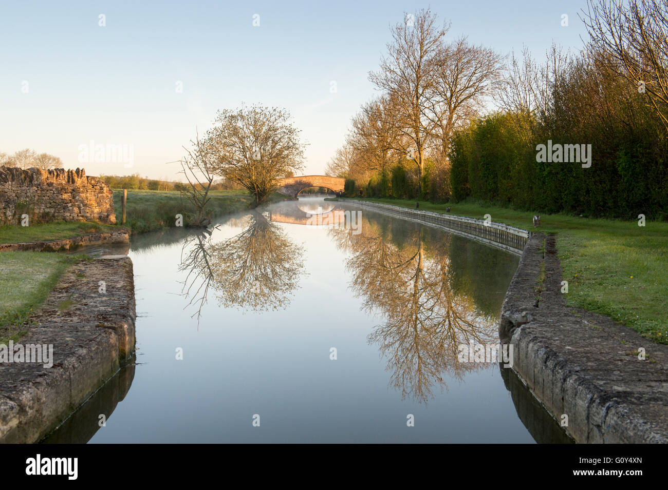 The oxford canal morning light reflections at Cropredy, Oxfordshire, England - Stock Image