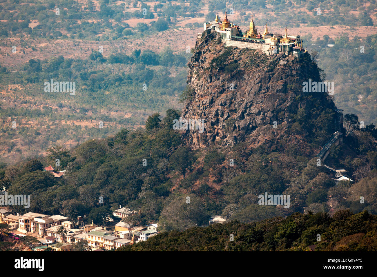 A view from above on the whole of monasteries, stupas and sanctuaries of Taung Kalat Mount Popa (2,427 ft or so). - Stock Image