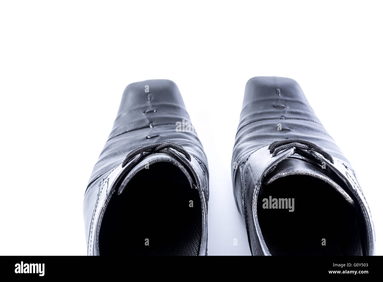 Old Mens shoes on white background,selective focus. - Stock Image