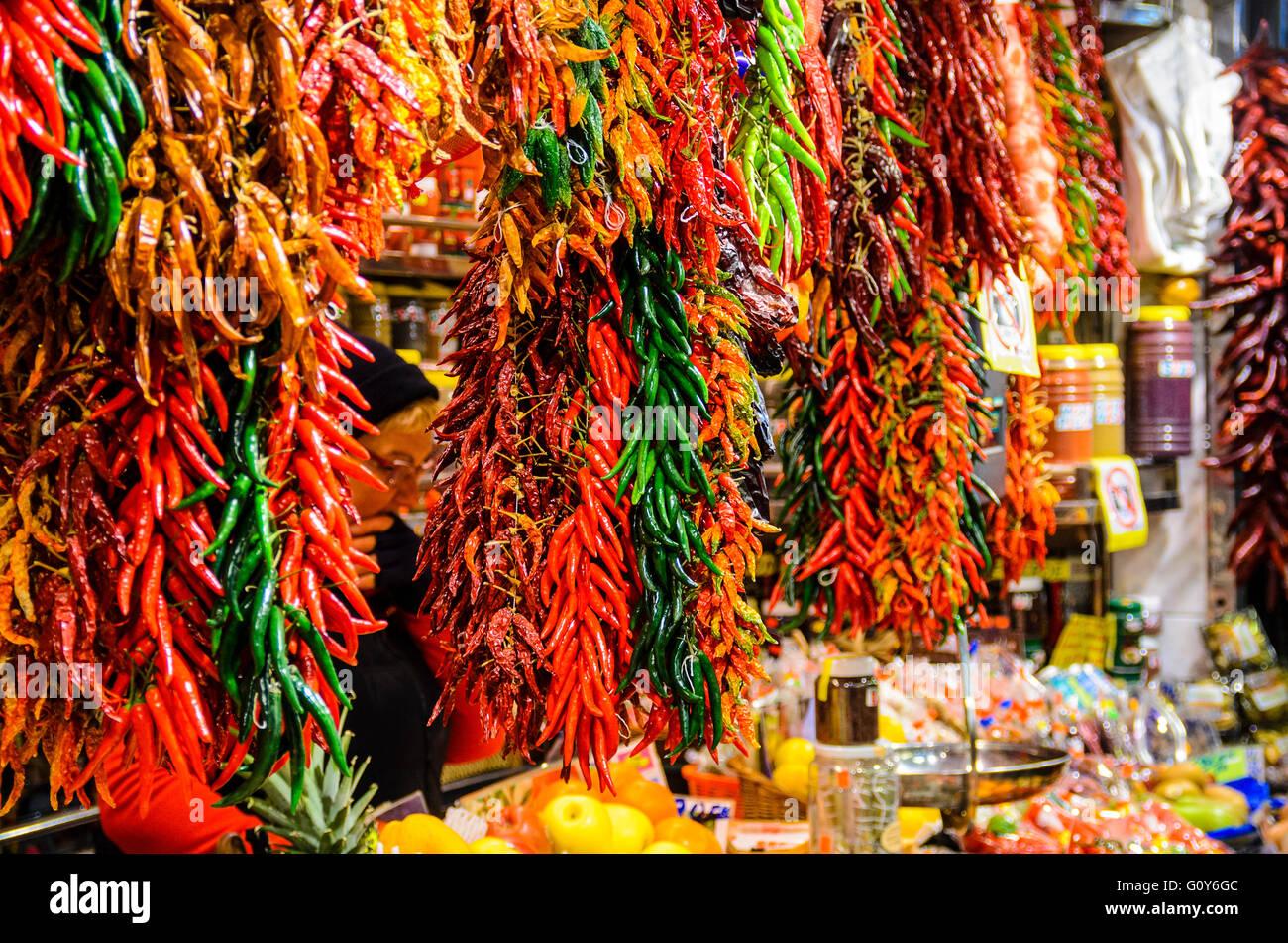Stall selling chillies in Mercat de Sant Josep de la Boqueria, a market in Ciutat Vella Barcelona Catalonia Spain - Stock Image