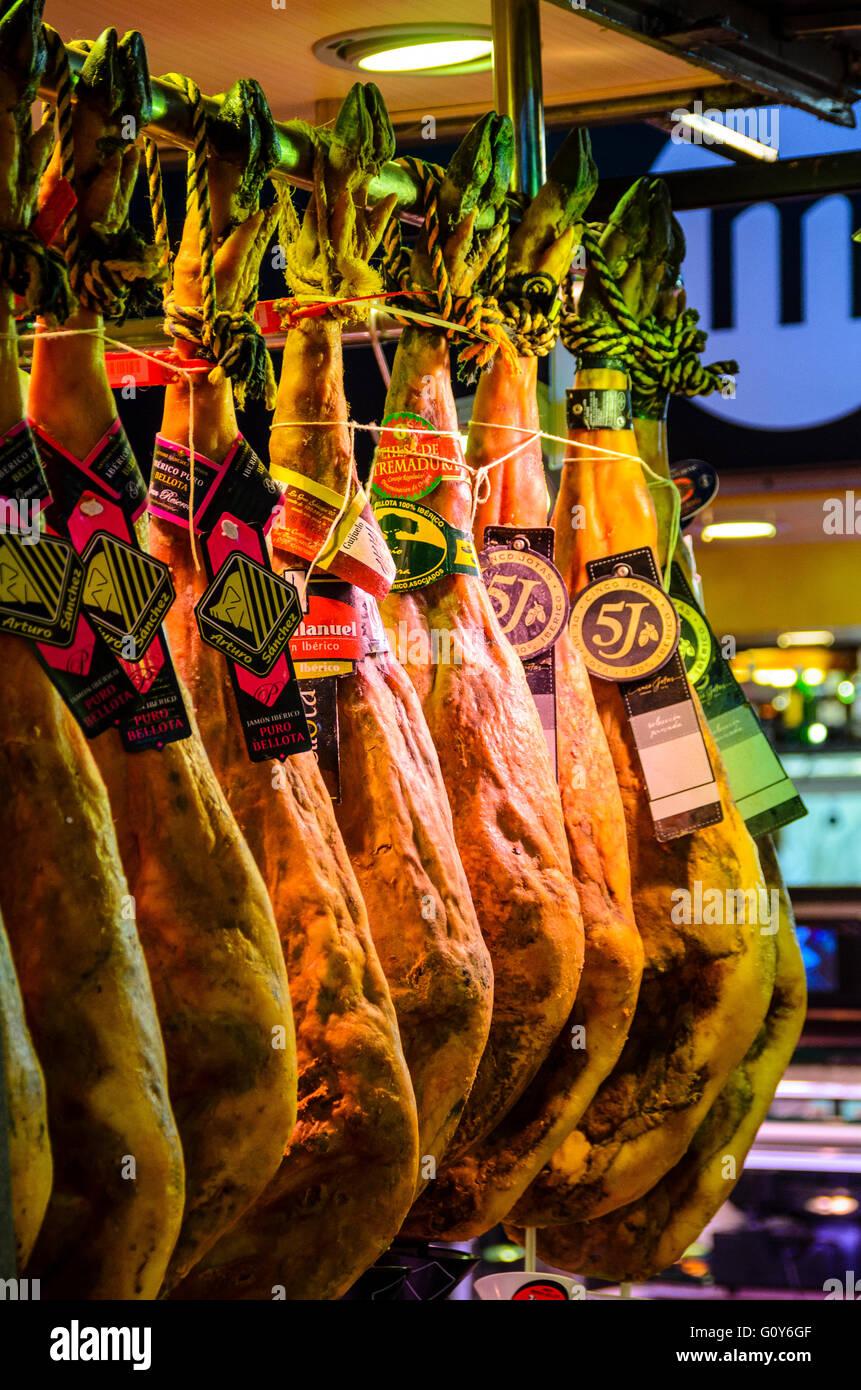 Iberico hams on a stall in Mercat de Sant Josep de la Boqueria, a market in Ciutat Vella Barcelona Catalonia Spain - Stock Image