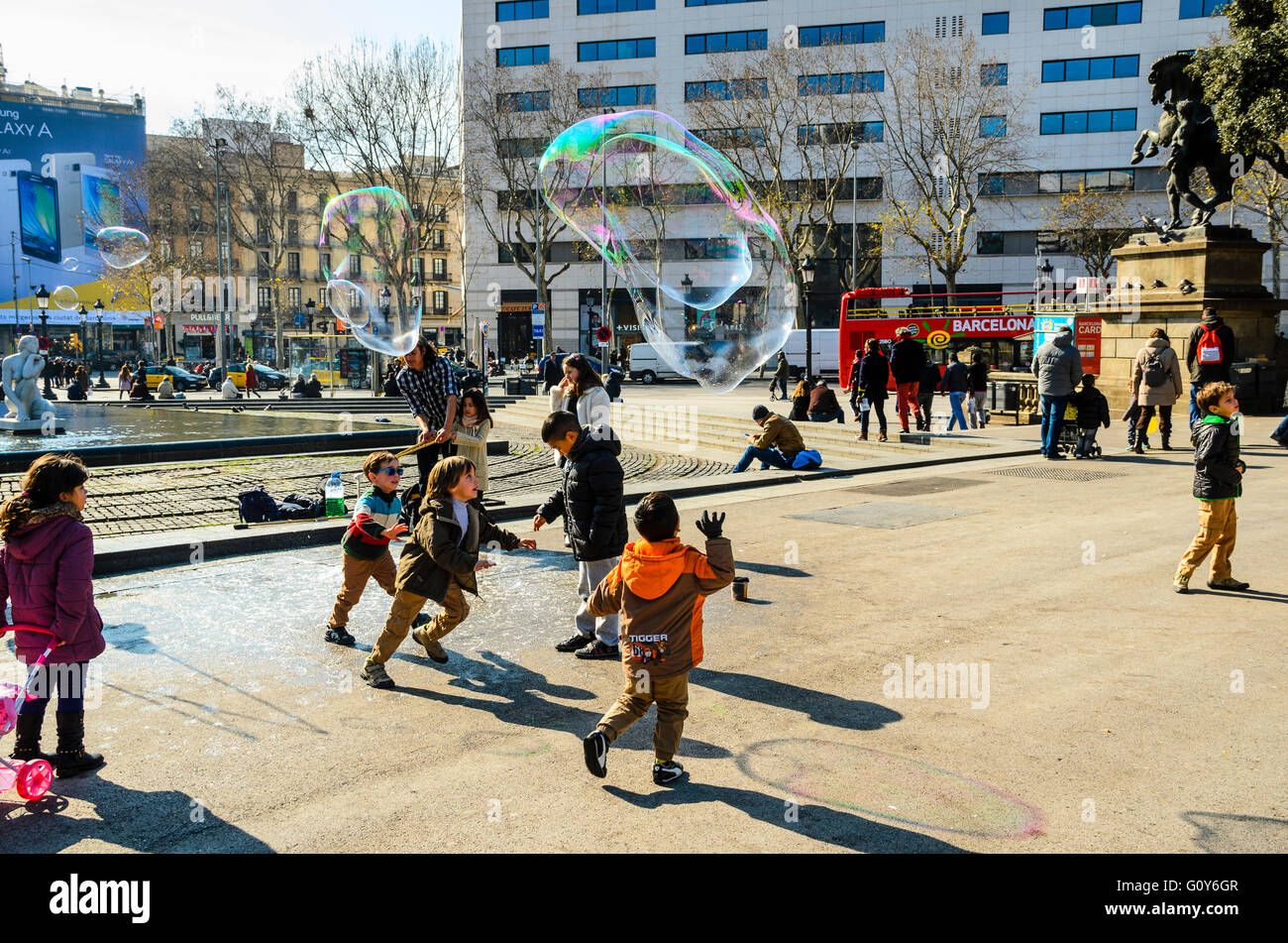 Street performers blow soap bubbles in Plaça de Catalunya Barcelona Catalonia Spain - Stock Image