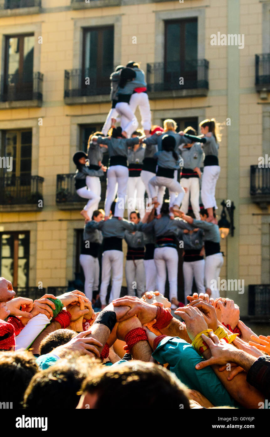 Castellers build human towers in Barcelona Catalonia Spain, a distinctive regional tradition - Stock Image
