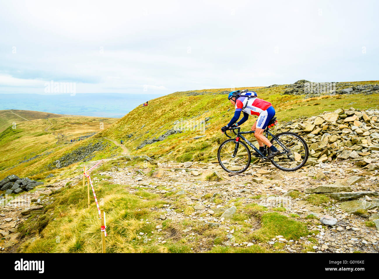 Rider descending Ingleborough in the 2015 Three Peaks cyclocross race, an annual event over three Yorkshire mountains - Stock Image