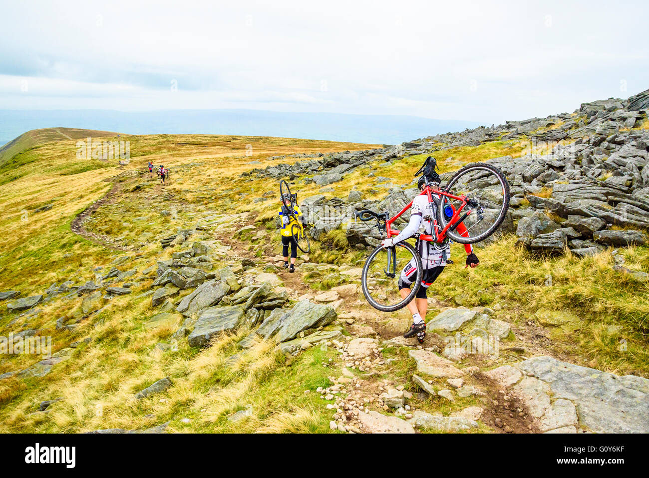 Riders descending Ingleborough in the 2015 Three Peaks cyclocross race, an annual event over three Yorkshire mountains - Stock Image