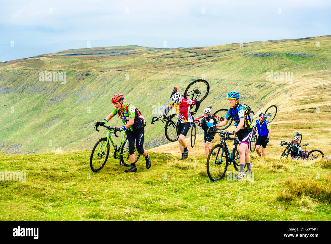 Riders ascending Ingleborough in the 2015 Three Peaks cyclocross race, an annual event over three Yorkshire mountains - Stock Image