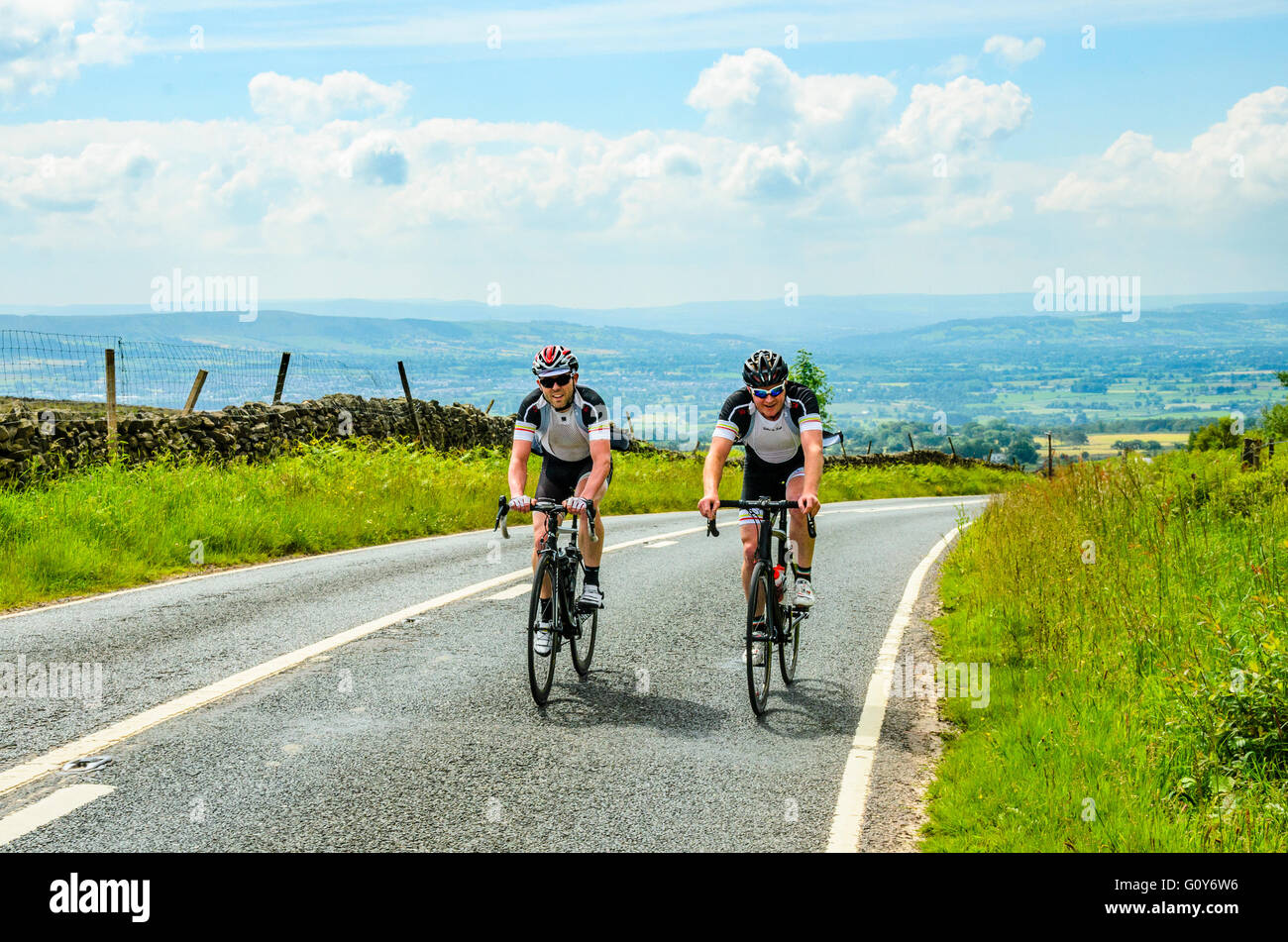 Cyclists on the climb of Waddington Fell above the Ribble valley Lancashire - Stock Image