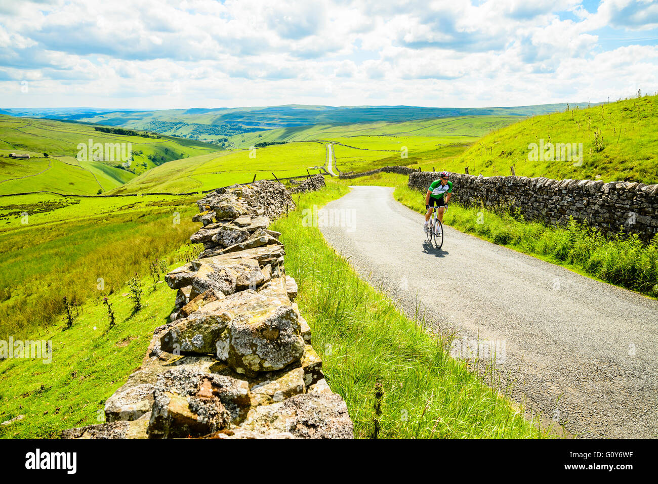 Cyclist near the top of the climb of Park Rash above Wharfedale in Yorkshire - Stock Image