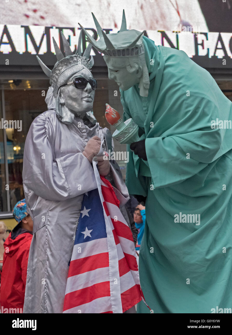 Two costumed characters who solicit money for photographs in Times Square in midtown Manhattan, New York City - Stock Image