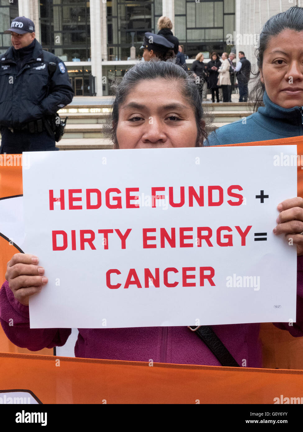 Latin American woman protesting about hedge funds in front of Lincoln Center on the Upper West Side of Manhattan, - Stock Image