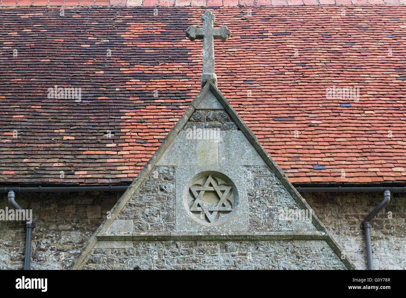 St Peters church porch stone star and cross detail, Little Wittenham, South Oxfordshire, England - Stock Image