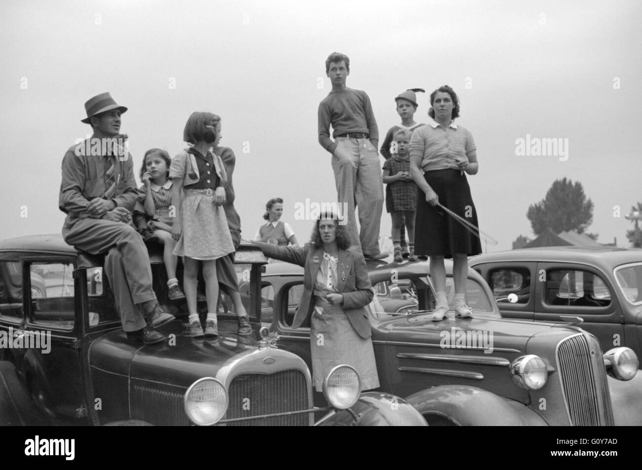 Spectators at Champlain Valley Exposition, Essex Junction, Vermont, USA, by Jack Delano for Farm Security Administration, - Stock Image