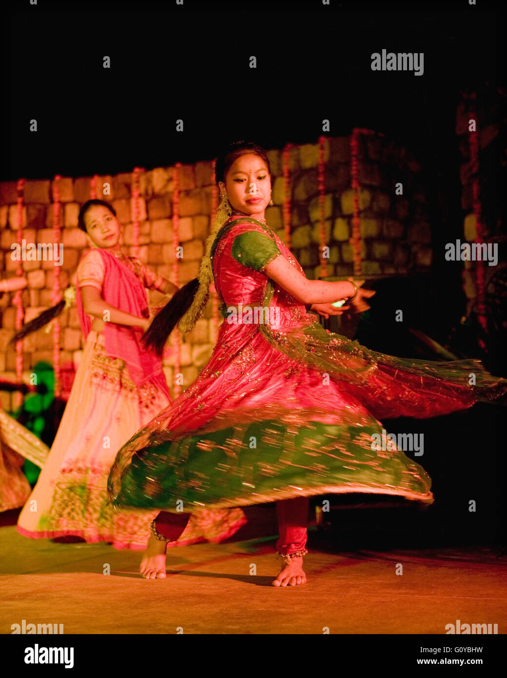 A local dance troupe of orphaned teenagers performs traditional Indian folk dances. Ananda in the Himalayas. India Stock Photo