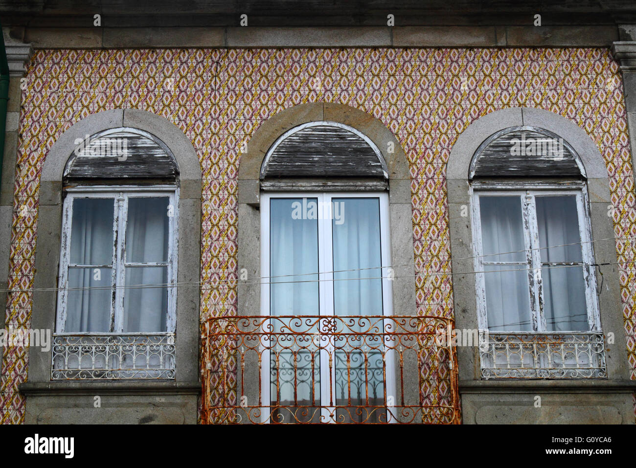 Detail of windows, balcony with new door and ceramic tiles on wall ...