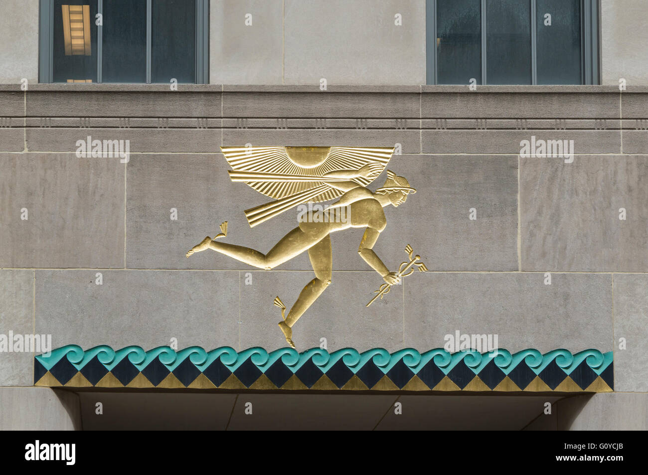 Close up of art deco relief of winged Mercury in gold and turquoise above a door in Channel Gardens, Rockefeller - Stock Image