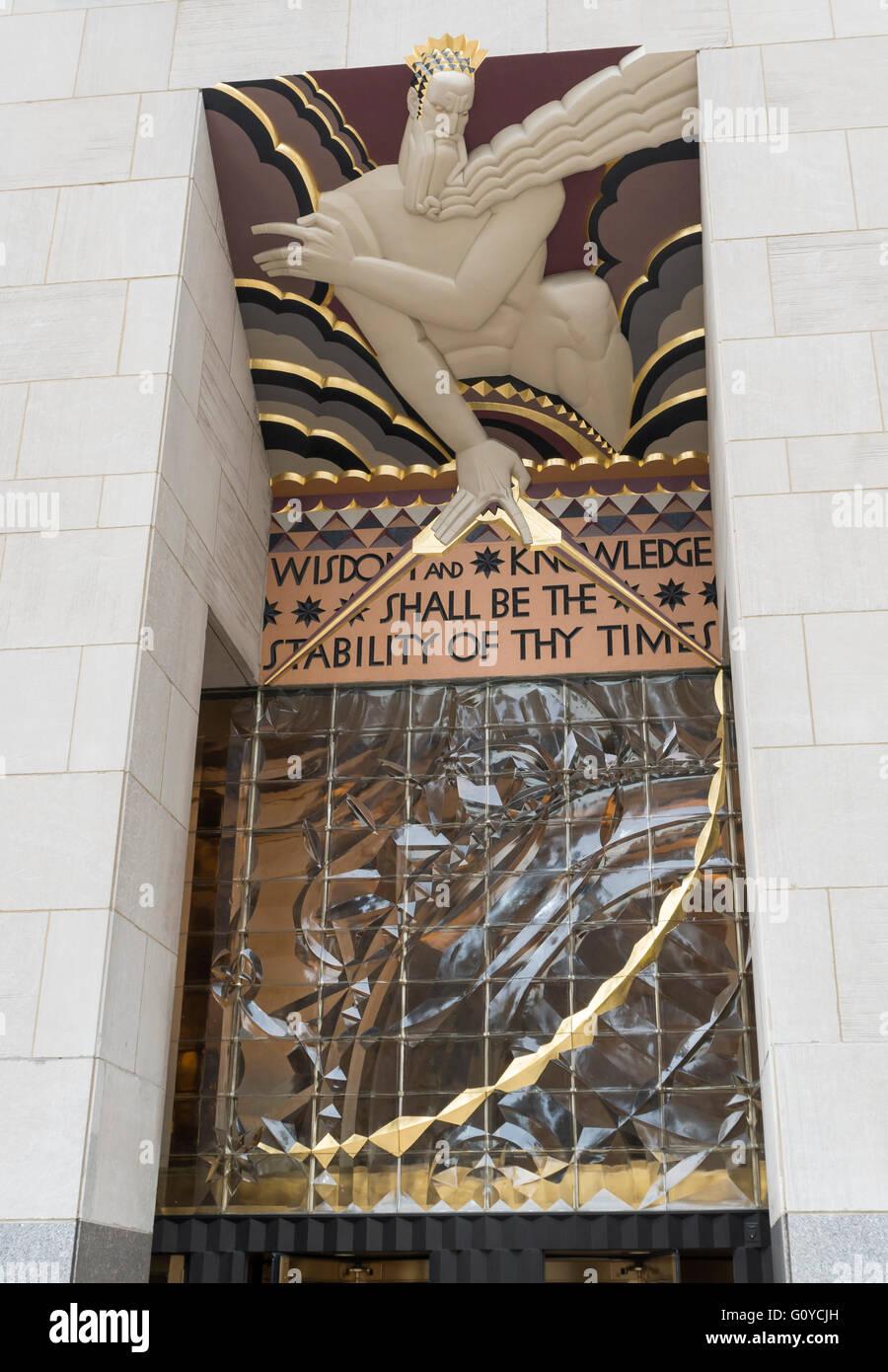 "Architectural sculpture ""Wisdom"" by Lee Lawrie above the main entrance to 30 Rockefeller Center (Comcast Building) Stock Photo"