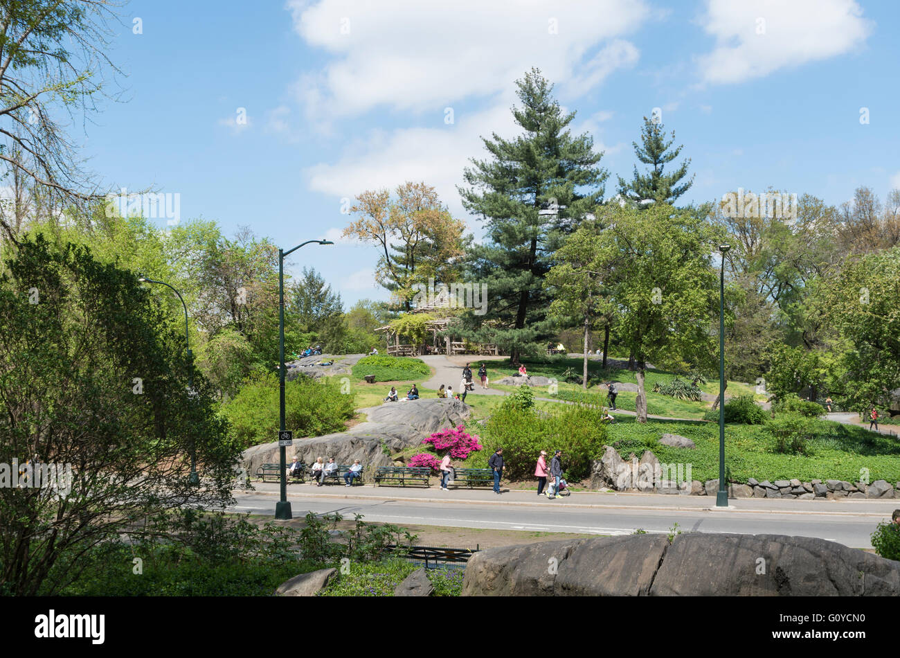 View of Central Park South, New York, in Spring looking towards Cop Cot with paths, people, rocks and trees on a - Stock Image