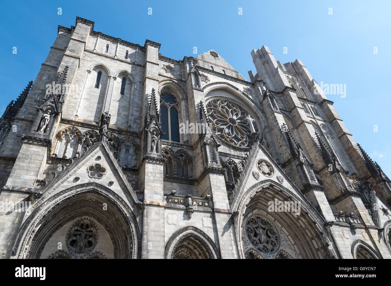 View of top of The Cathedral Church of St. John the Divine with rose window in New York - Stock Image