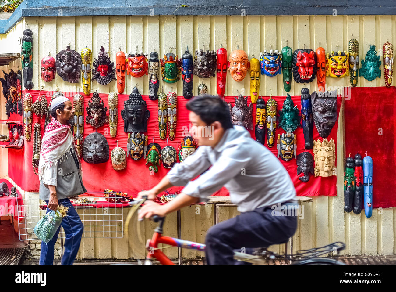 Tibetan-style carved masks at a street vendor in Thamel area, Kathmandu, Nepal. © Reynold Sumayku - Stock Image