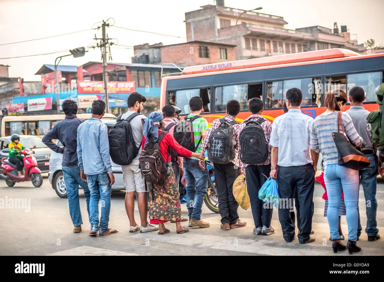 A crowd prepare to cross the busy street of Kathmandu, Nepal. © Reynold Sumayku - Stock Image