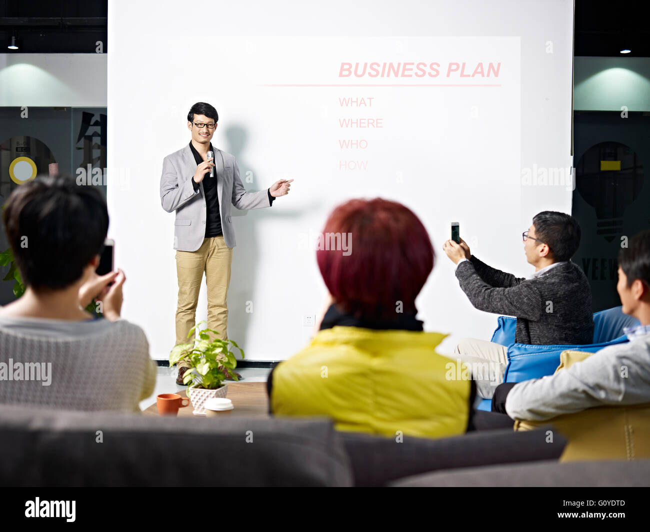 young asian entrepreneur presenting business plan for new project
