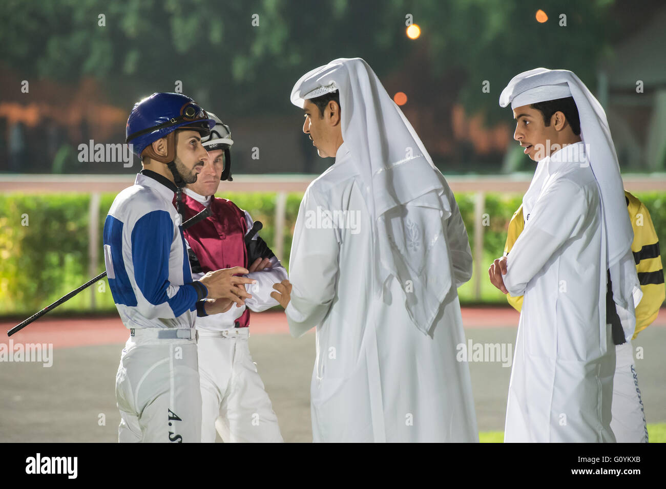 Qatar Racing & Equestrian Club, Doha.  Qatar 5th May 2016.  Trainer Jassim Mohammed Ghazali speaking to jockey Alberto Stock Photo