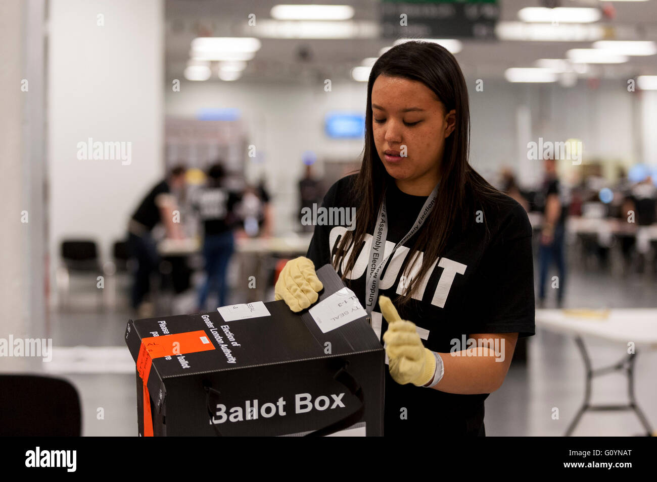 London, UK.  6 May 2016. A counter opens a ballot box for processing. Votes for the London Mayoral elections and - Stock Image