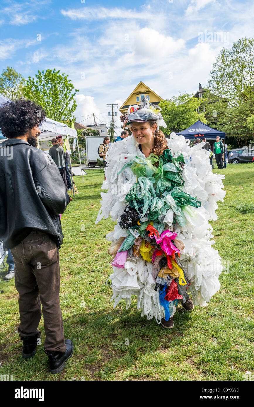 Earth Day Vancouver, woman wearing dress made from plastic bags. - Stock Image