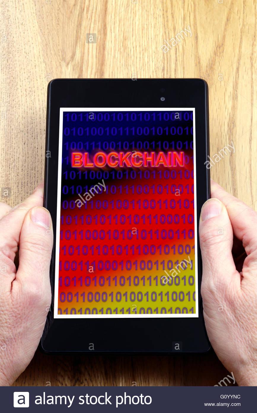 Blockchain shown on a tablet computer, Dorset, England, UK - Stock Image