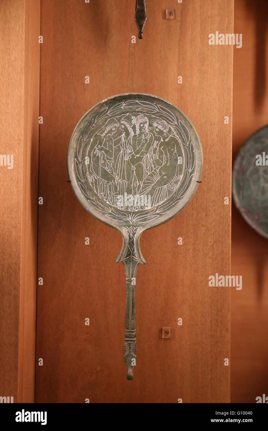 Etruscan art. Mirror. Bronze. 4th-3rd century BC. Italy. Louvre Museum. France. Paris. - Stock Image
