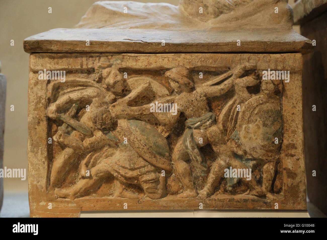 Etruscan cinerary urn. Hero fighting with a plow. Chiusi, Italy. 2nd c. BC. Terracotta. Louvre Museum. Paris. France. - Stock Image