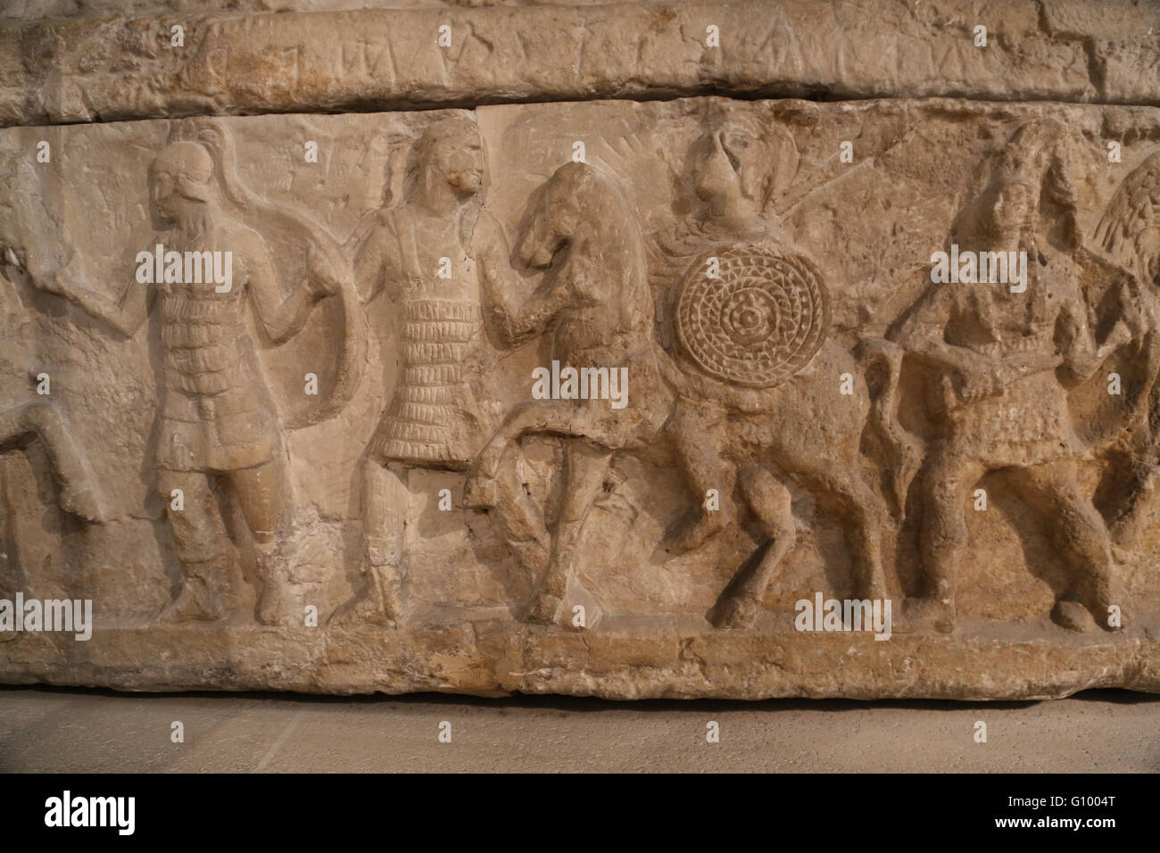 Etruscan cinerary urn. Relief. Soldiers.  Chiusi, Italy. 3rd c. BC. Terracotta. Louvre Museum. Paris. France. - Stock Image