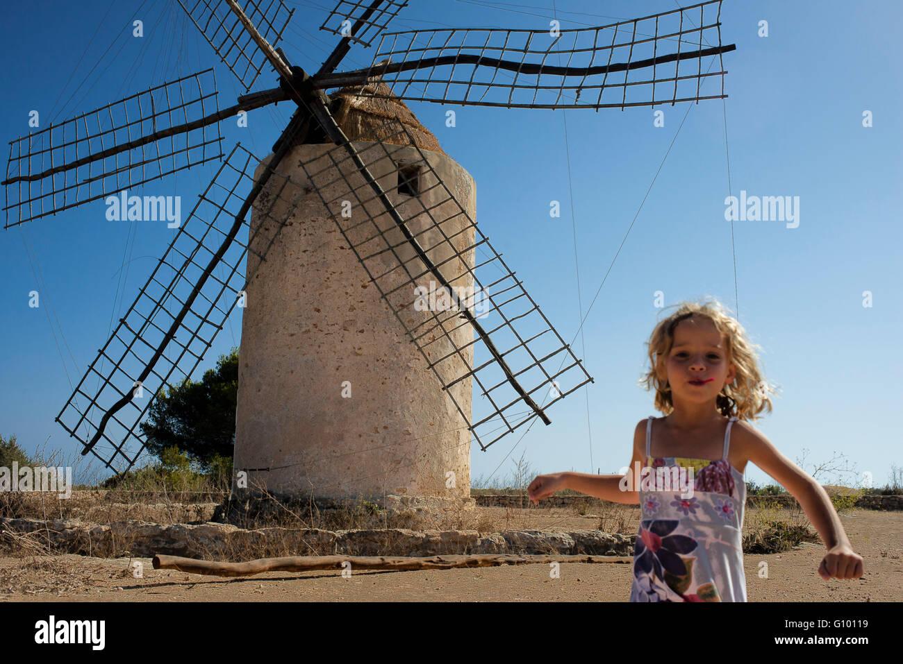 Funy girl in the windmill, Formentera, Balearic Islands, Spain. Old Windmill in el Pilar de la Mola on the island - Stock Image