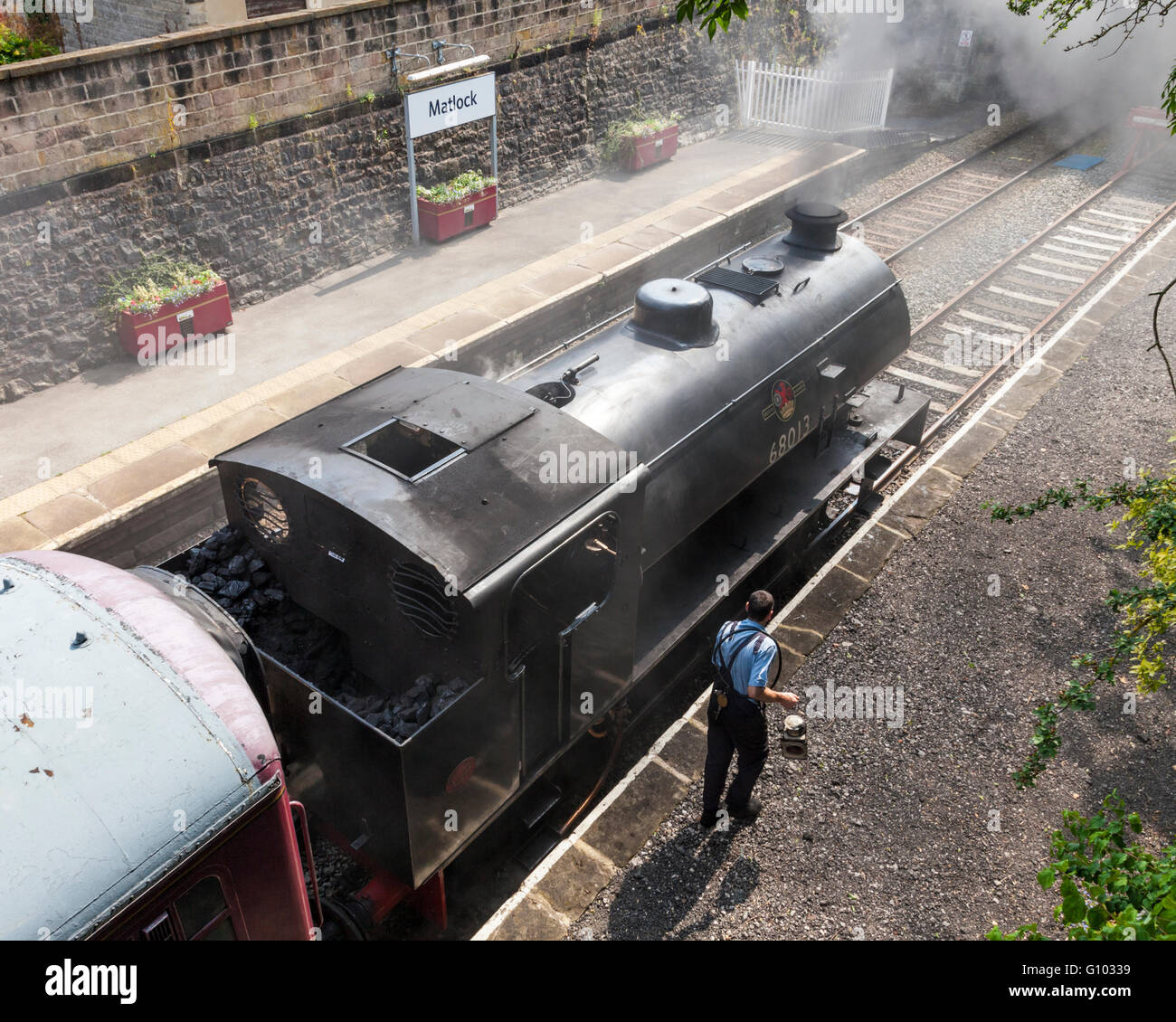 Peak Rail steam locomotive no. 68013 and engine driver at Matlock Station, Derbyshire, England, UK - Stock Image