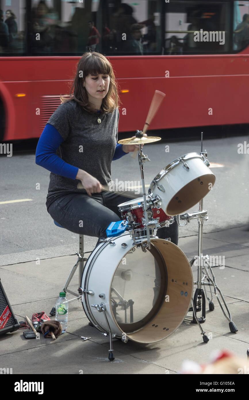 street musician,  London   female drummer - Stock Image