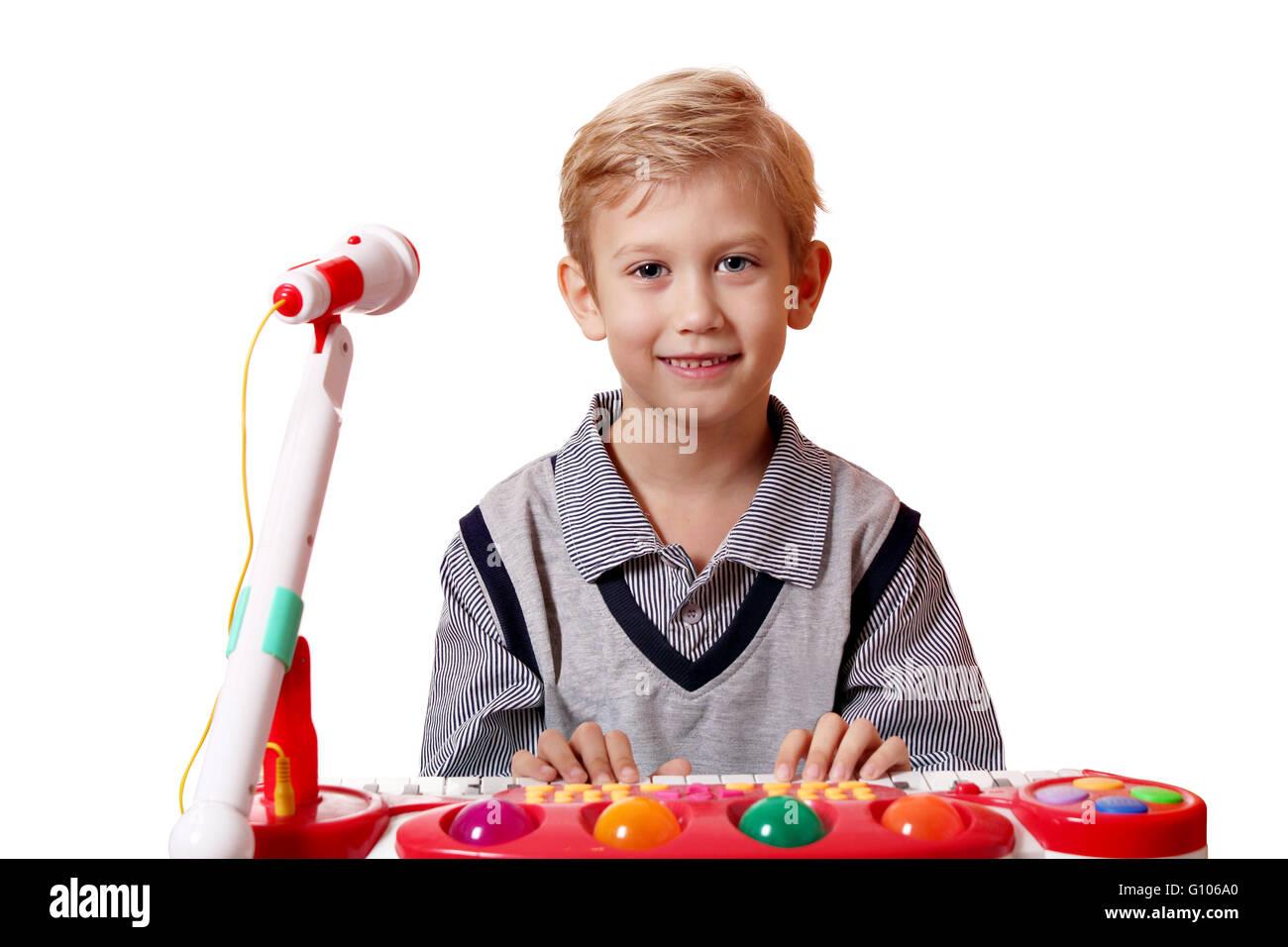 boy play music - Stock Image