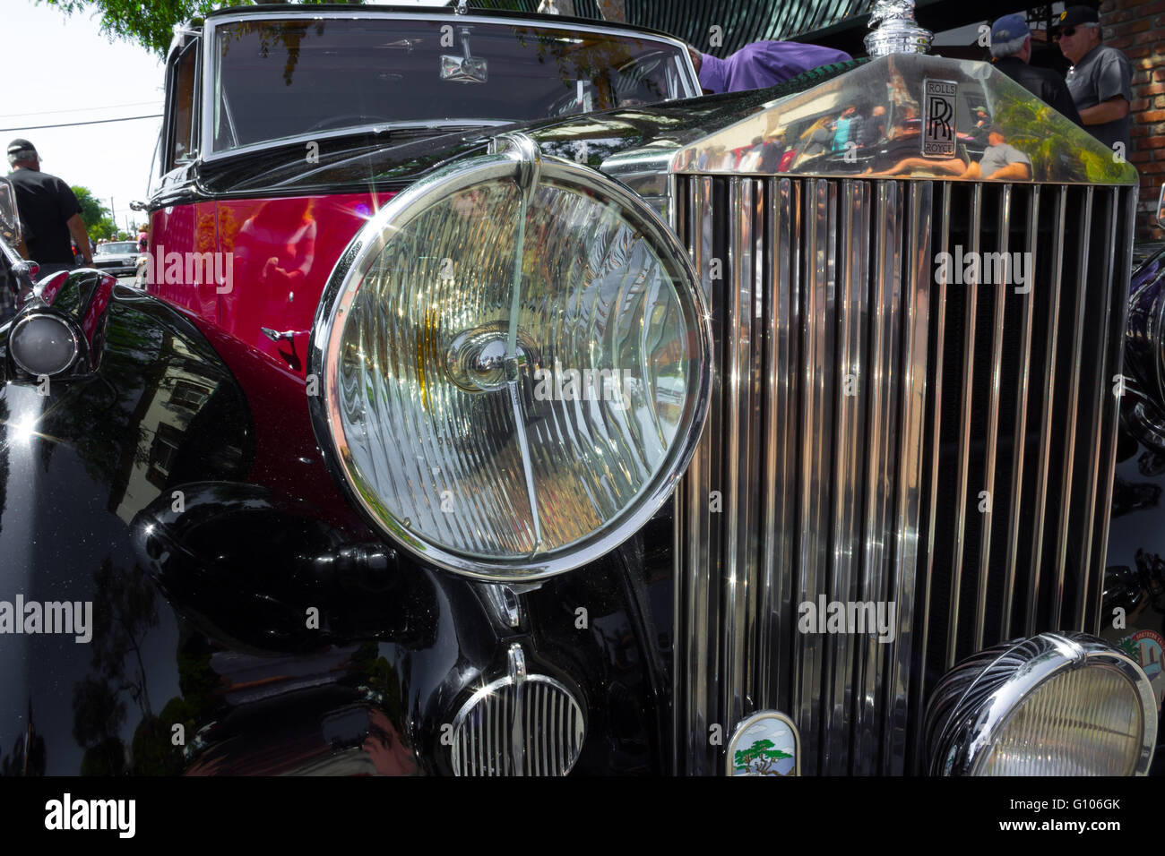 1948 classic Rolls Royce with magenta and black colors shown from the front - Stock Image