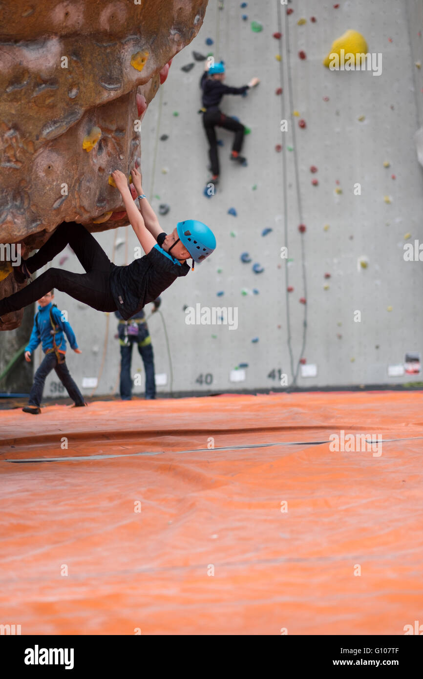Climber bouldering at an indoor rock climbing centre in Ratho Edinburgh - Stock Image