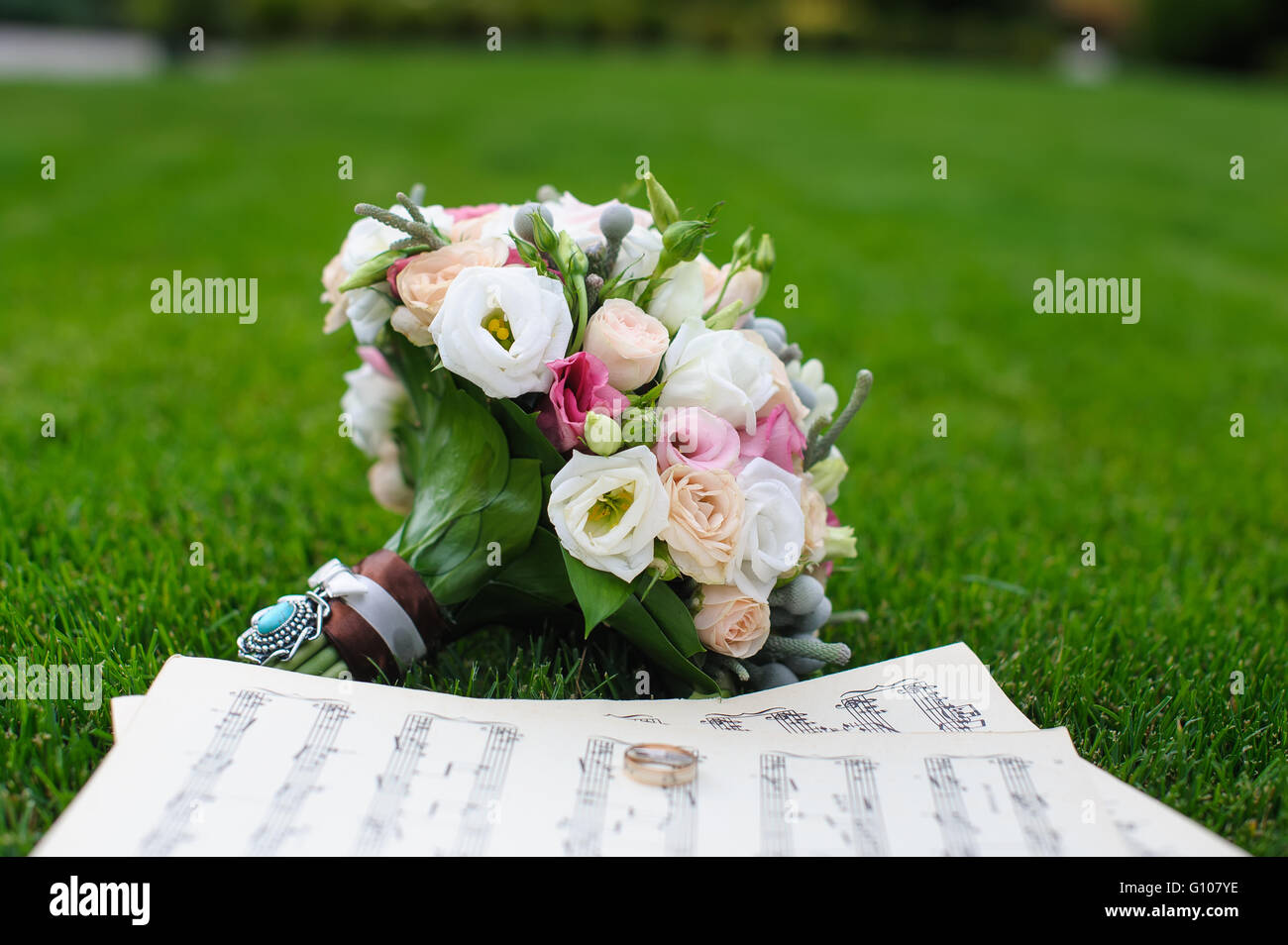 Two Wedding Rings On A Sheet Of Paper With Music Notes Wedding
