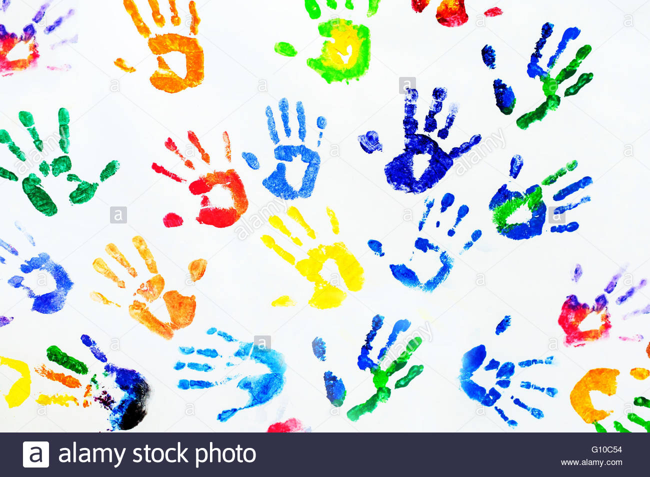 Photography of rainbow colors arm prints on white paper - Stock Image