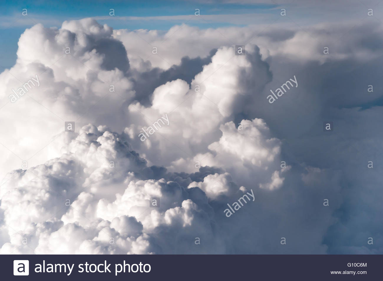 The fluffy clouds formation, view from airplane windows. Sunny sky abstract background, beautiful cloudscape, vertical - Stock Image