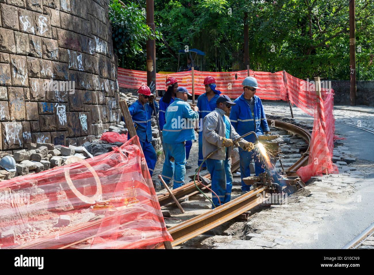RIO DE JANEIRO - MARCH 24, 2016: Railway construction workers weld metal for trackwork the new bonde train in Santa - Stock Image