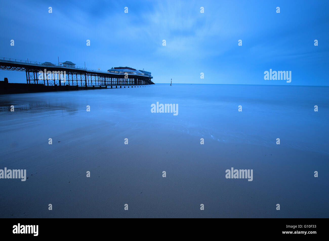 Long Exposure of the beach at Cromer Pier just before sunset - Stock Image