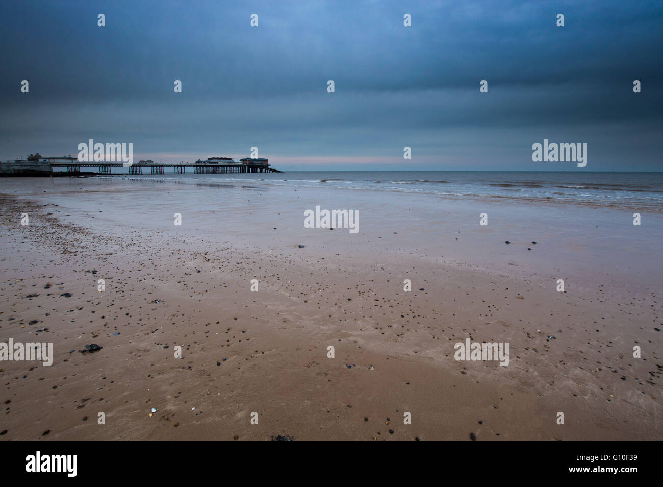 Cromer Pier, Norfolk, just before sunset, in muted tones - Stock Image