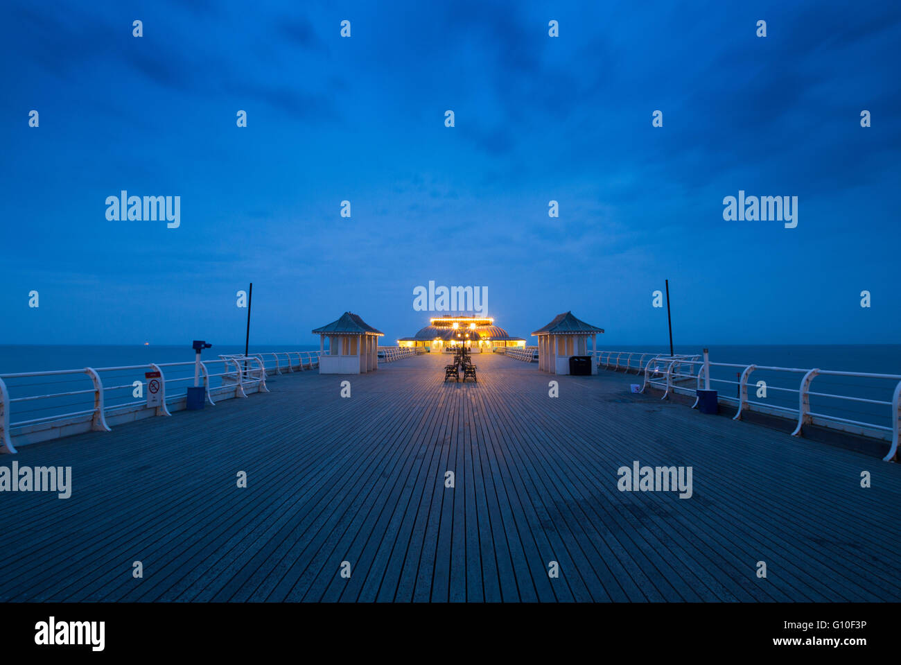 Cromer Pier, at sunset, Norfolk - Stock Image