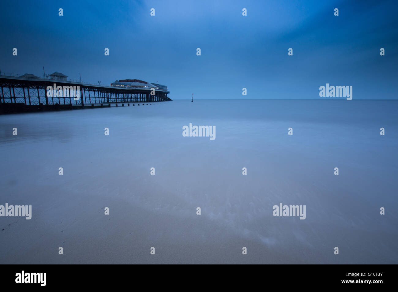 Long Exposure on the Norfolk Coast, at Cromer Pier - Stock Image