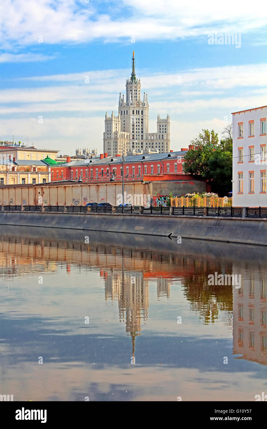 Stalin's Empire style building and reflection in the water in Moscow, Russia Stock Photo