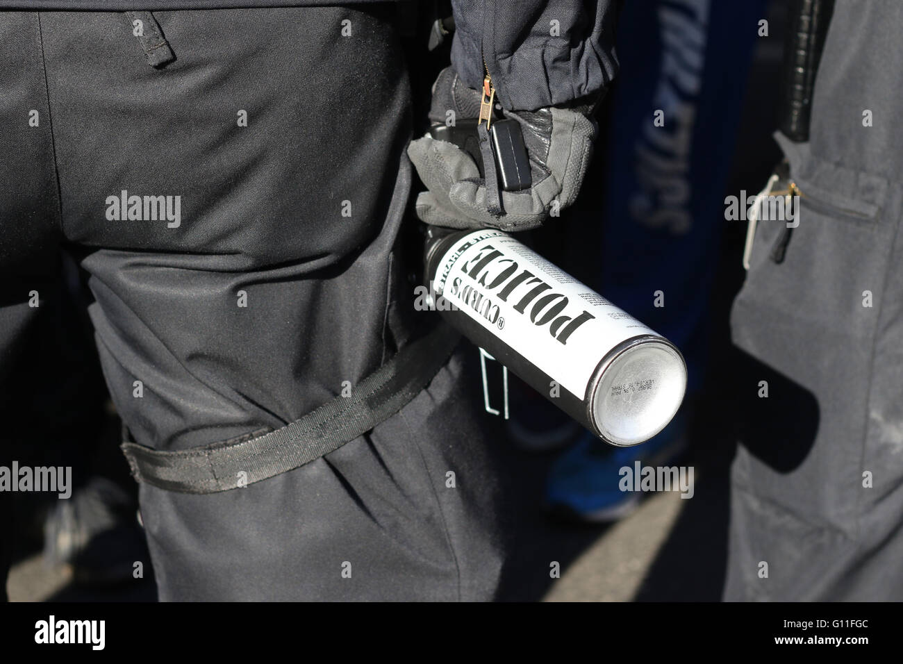 Riot police hold canisters of CS gas. Thousands of anti-fascist campaigners held a counter protest against right - Stock Image
