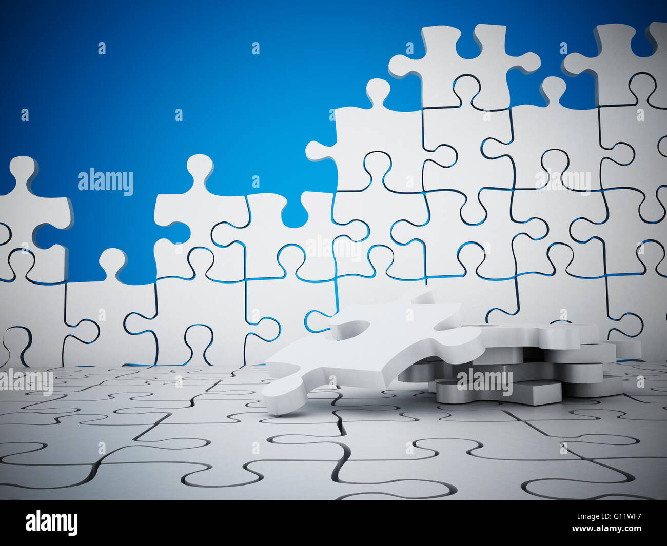 Puzzle wall with missing pieces on blue background - Stock Image